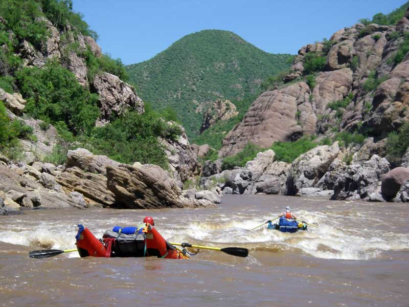 Downstream are more Class III rapids, most with big waves.