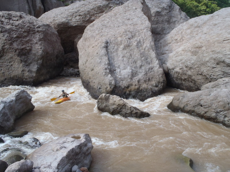 Rocky Contos in the massive white boulder section of the river. ©Lacey Anderson
