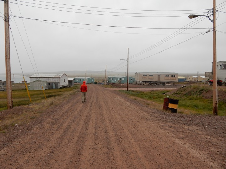 Streets of Baker Lake on a rainy day foundations are built above ground due to permafrost